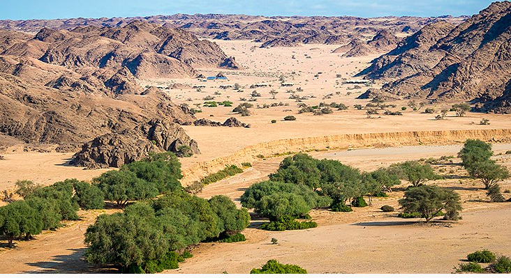 Can you see yourself here?  (I can!)  Serra Cafema Camp is set in the middle of the desert on the Kunene River